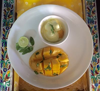 Grilled Mango, topped with lemon n mint, served with Ice cream