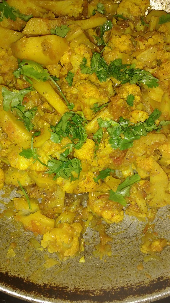 Now check if the patatoes and cauliflower have become tender,the sabzi is ready, garnish it with coriander and garam masala,serve it with chapati
