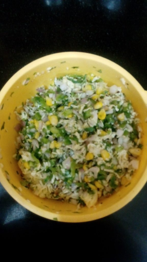 Add onion, green chillies, salt, pepper, cheese ,capsicum ,coriander leaves ,chilli flakes,corn in it .