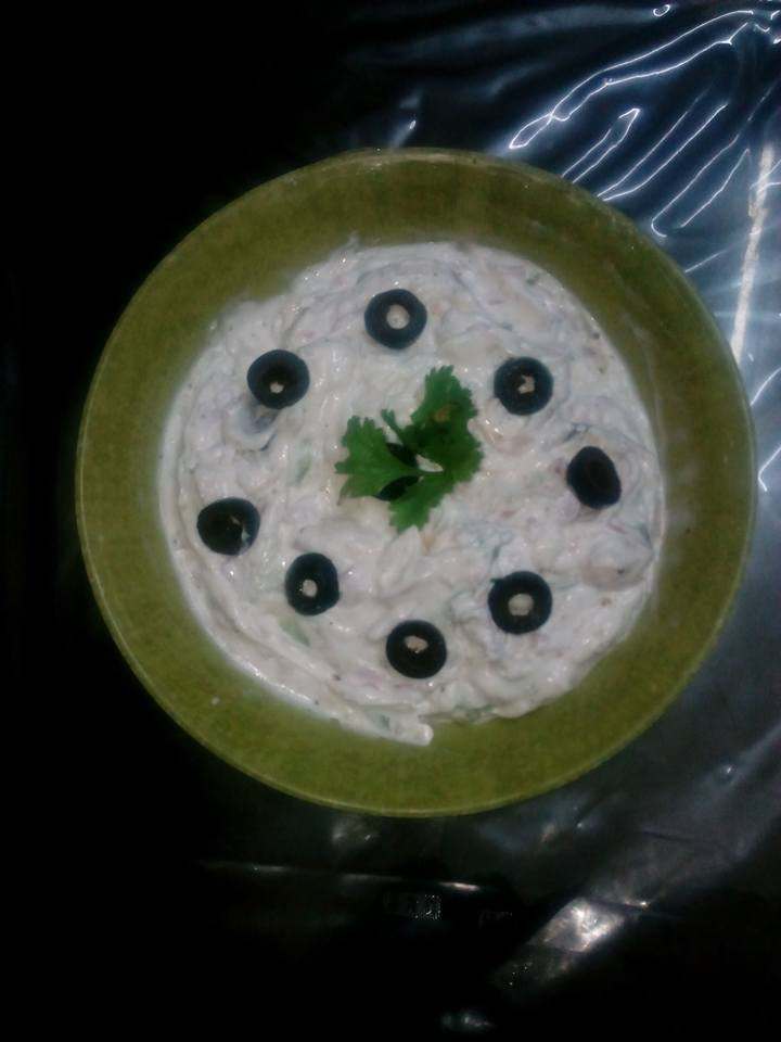 Take a bowl,add mayonnaise, hang curd, onion, green chillies, salt ,black pepper,chopped black olives in it and mix well.