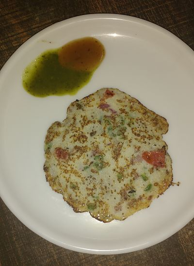 Now uttapam is ready and serve it with tamarind and coriander chutney