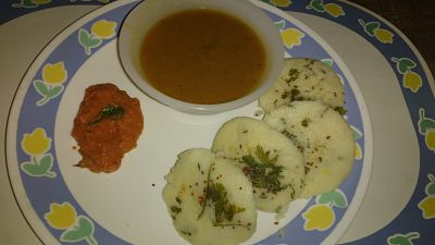 Stuffed idli with tomato chutney and sambhar