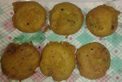 Now dip the balls prepared above intogram flour batter and deep fry it to make vadas.