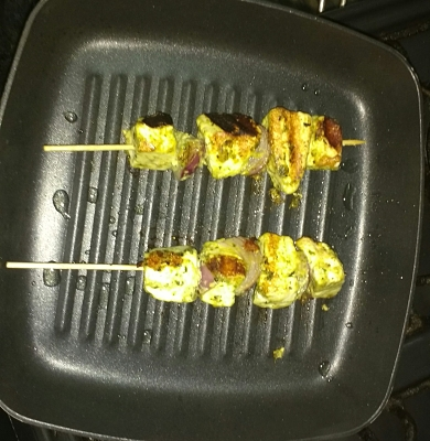 Now take a non stick pan and add tsp oil,when it turns hot cook paneer sticks by putting them in skewers.